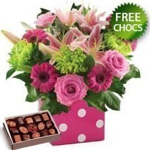 Rose, Gerbera And Lily Arrangement With Free Chocs